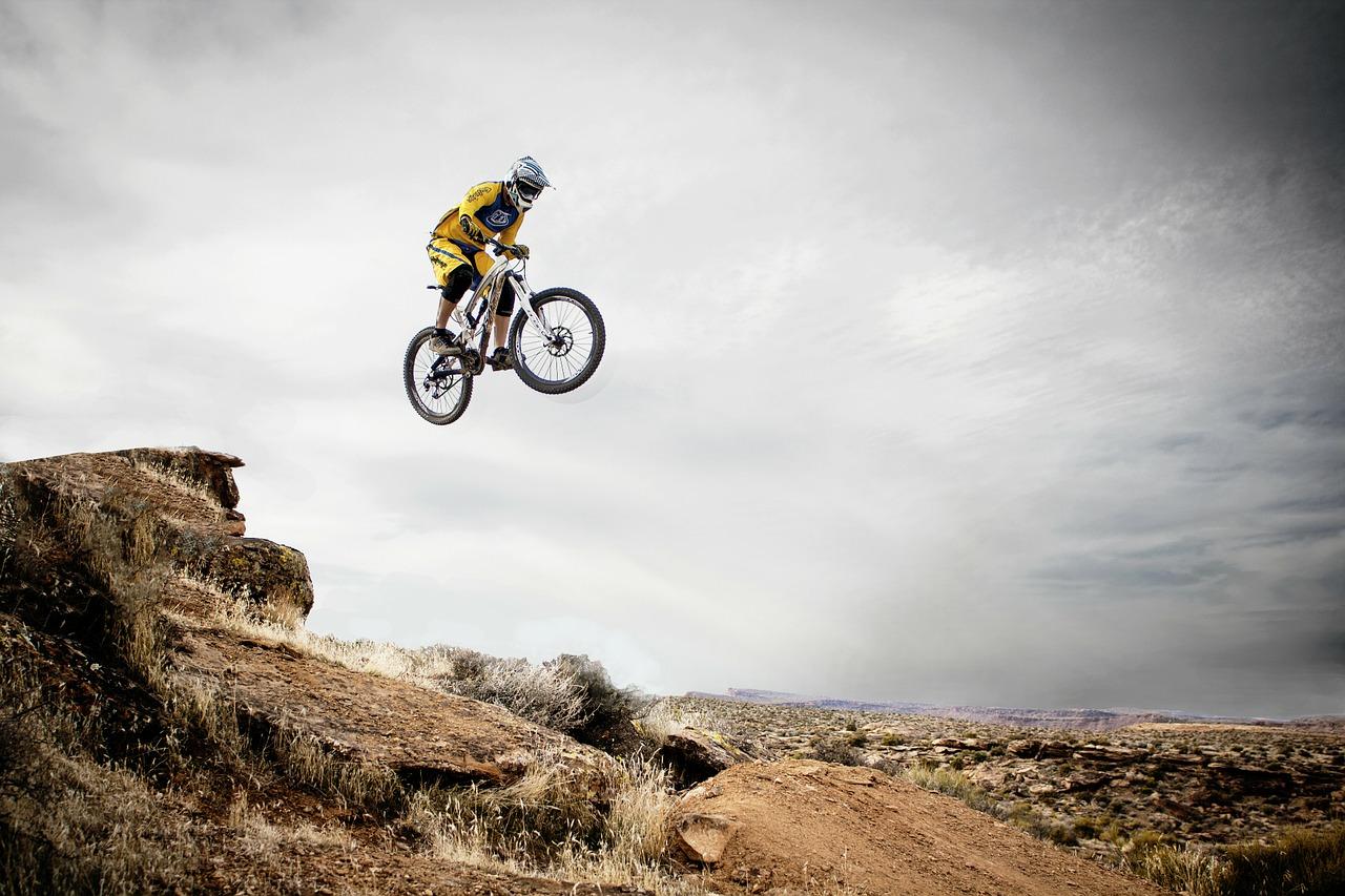 man doing a jump on a florida mountain bike trail