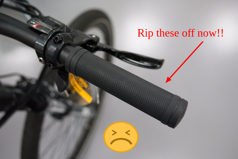 Image shows standard mountain bike grips provided by the factory. Get these removed!