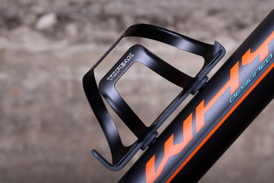 minimal looking water bottle cage mounted on a mountain bike frame