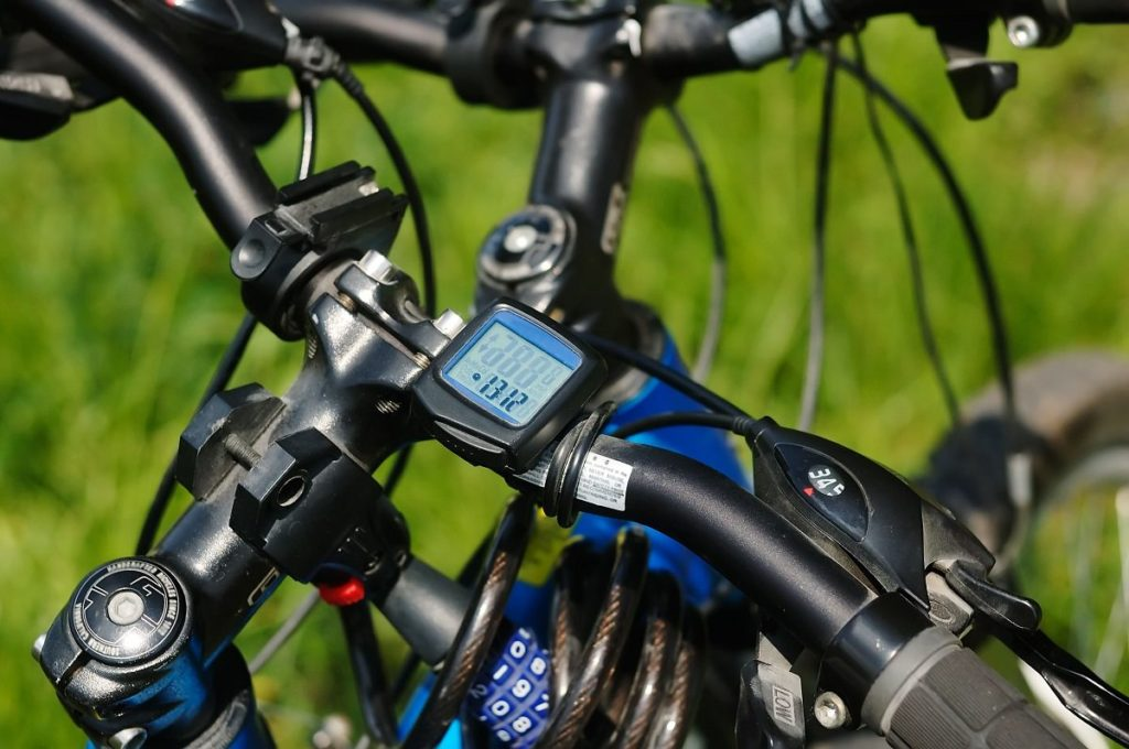 mountain bike computer mounted on handle bar for rider to view stats